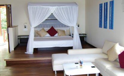 Hilton Labriz Seychelles ocean pavilion bedroom four poster beds lounge area