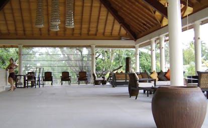 Hilton Labriz Seychelles reception covered pavilion seating area reception desk
