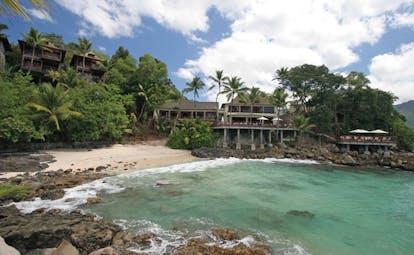 Hilton Northolme Seychelles beach palm trees villas