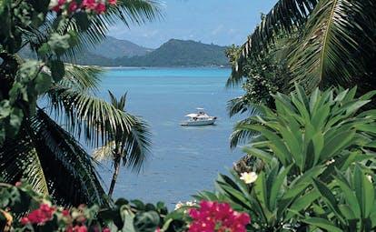 Hotel L'Archipel Seychelles ocean view flowers boat