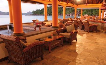 Domaine de la Reserve Seychelles bar pavilion fountain wicker seating ocean view