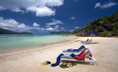 Domaine de la Reserve Seychelles beach sun loungers grassy hills