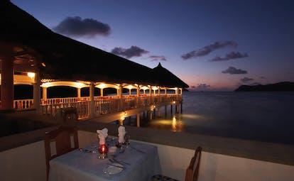 Domaine de la Reserve Seychelles evening outdoor dining jetty