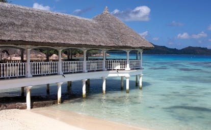 Domaine de la Reserve Seychelles jetty into ocean with thatched roof