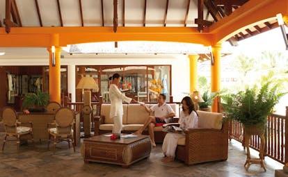 Domaine de la Reserve Seychelles outdoor lounge covered pavilions seating area drinks