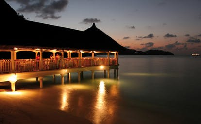 Domaine de la Reserve Seychelles night jetty lighting ocean view