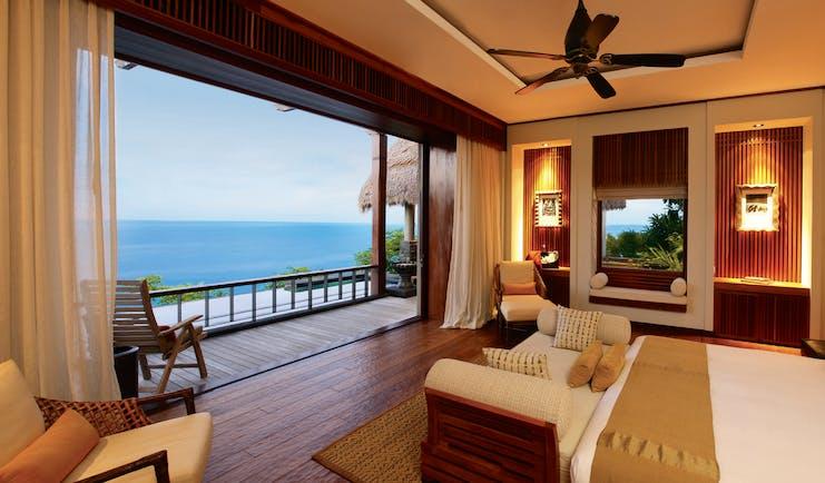 Maia Seychelles villa lounge area modern décor terrace overlooking ocean
