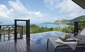 Raffles Praslin ocean view villa terrace with private plunge pool, sun lounger, views over the ocean