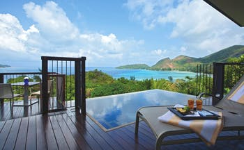 Raffles Praslin ocean view villa terrace with private plunge pool, sun lounger, views over the ocean