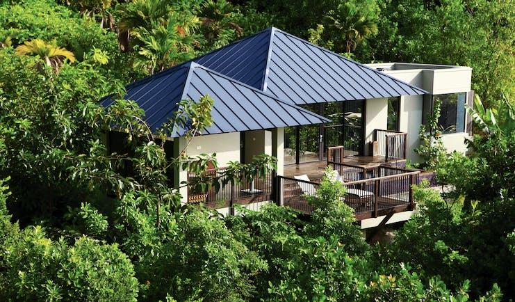 Raffles Praslin pool villa exterior, villa with terrace nestled amongst tropical greenery