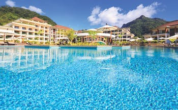 Savoy Seychelles pool, hotel building in background