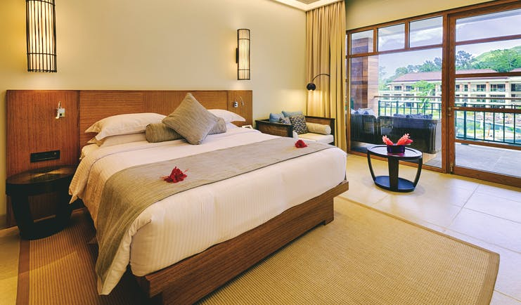Savoy Seychelles standard room, double bed, access to balcony, bright modern decor