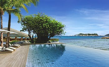 Six Senses Zil Pasyon infinity pool, wooden decking overlooking sea