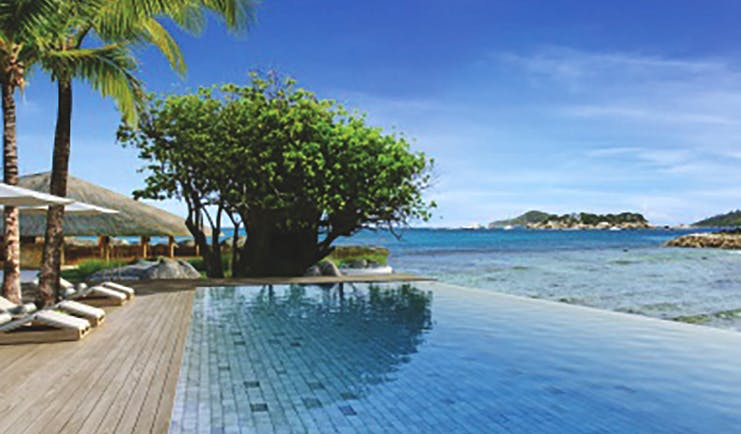 Six Senses Zil Pasyon infinity pool, wooden decking overlooking sea