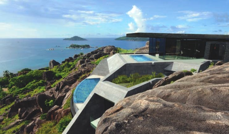 Six Senses Zil Pasyon residence, cliffside building with private pools and views out to sea