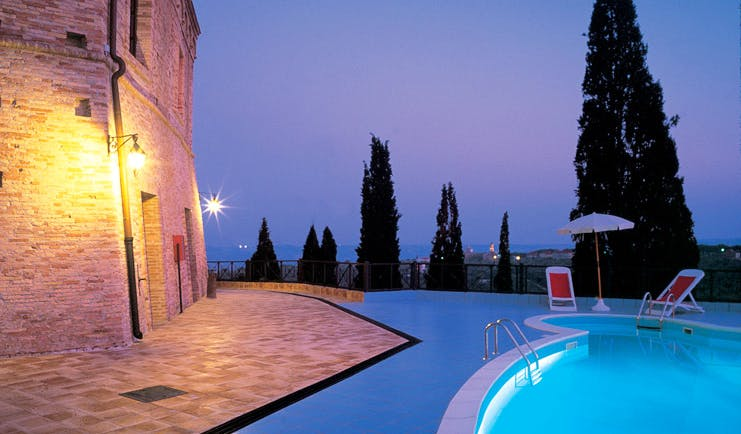 Castello Chiola Abruzzo pool at night terrace sun loungers