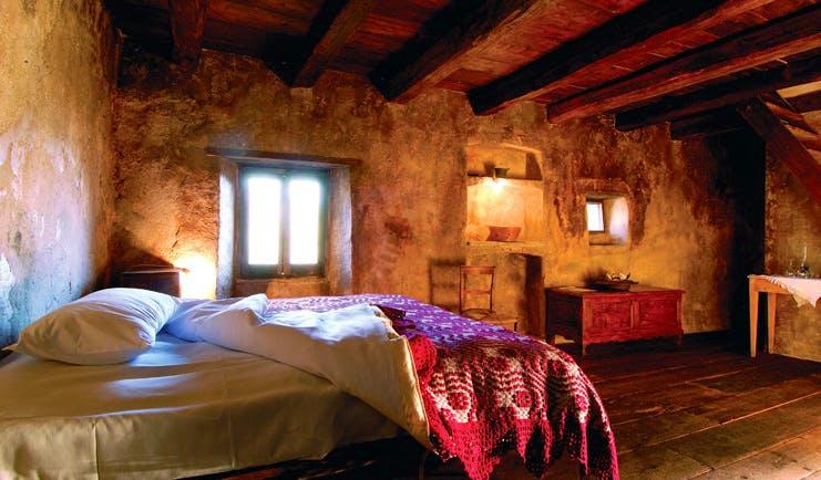 Sextantio Albergo Diffuso Abruzzo classic room bed roof beams authentic architecture