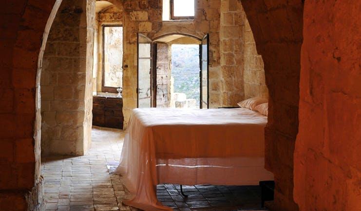 Sextantio Albergo Diffuso Abruzzo guestroom bed authentic architecture