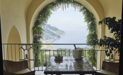 Hotel Caruso Amalfi Coast indoor balcony seating area champagne overlooking the coast line