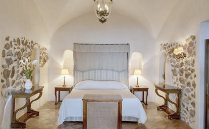 Hotel Caruso Amalfi Coast bedroom large bed stone detailing on walls