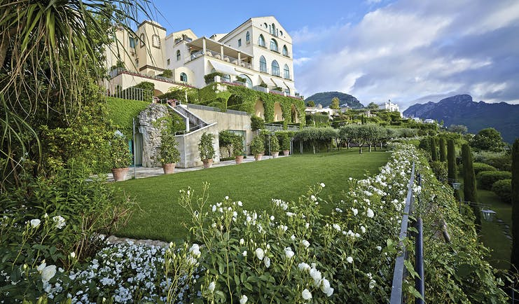 Hotel Caruso Amalfi Coast hotel exterior green lawns white flowers