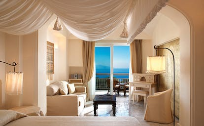 Capri Palace Hotel Amalfi Coast deluxe suite canopied bed sofa terrace elegant décor
