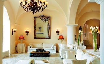 Capri Palace Hotel Amalfi Coast lounge sofas armchairs mirrors chandeliers
