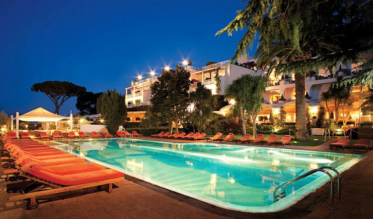 Capri Palace Hotel Amalfi Coast pool at night sun loungers hotel in background