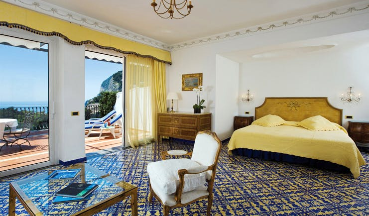 Casa Morgano Amalfi Coast deluxe junior suite bed chair ornate décor private terrace