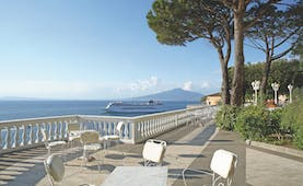 Grand Hotel Cocumella Amalfi Coast patio outdoor dining and seating area view of sea