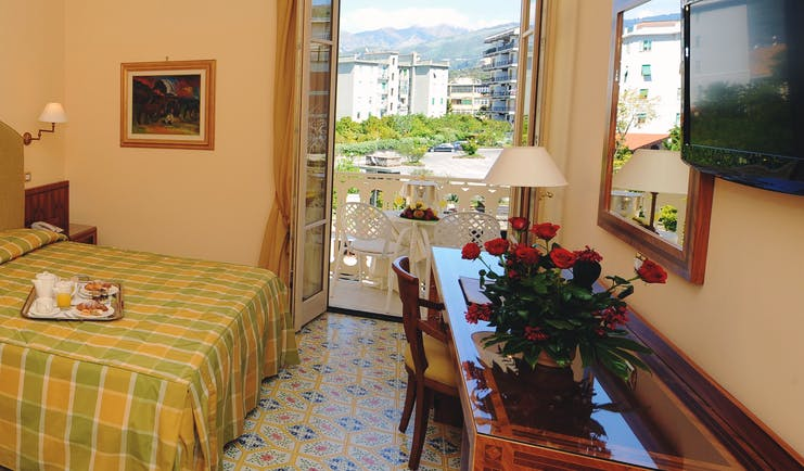 Hotel Antiche Mura Amalfi Coast comfort room double bed doors leading to balcony with table and chairs