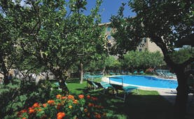 Hotel Antiche Mura Amalfi Coast pool sun loungers in citrus garden