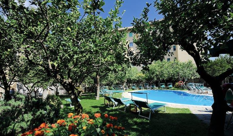 Hotel Antiche Mura Amalfi Coast pool sun loungers in citrus garden