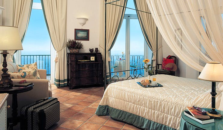 Caesar Augustus Amalfi Coast guest room bed sofa elegant décor sea views