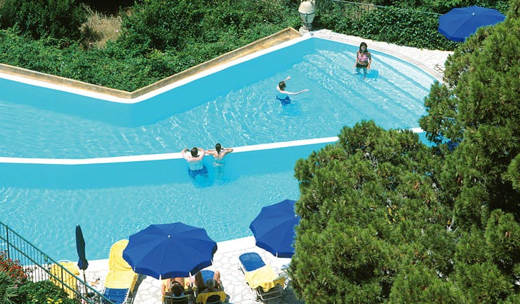 Caesar Augustus Amalfi Coast pool sun loungers umbrellas people playing in water