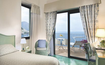 Hotel Miramalfi Amalfi Coast bedroom leading to balcony