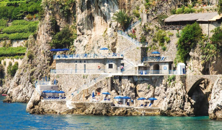 Hotel Miramalfi Amalfi Coast private beach terrace sun loungers and umbrellas