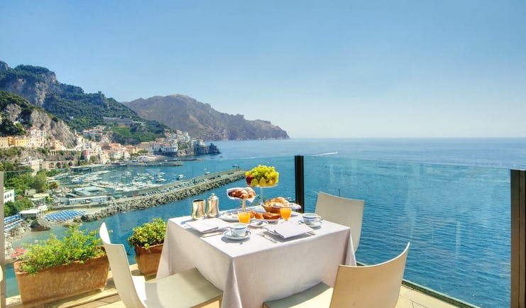 Hotel Miramalfi Amalfi Coast restaurant outdoor dining terrace glass walls sea views