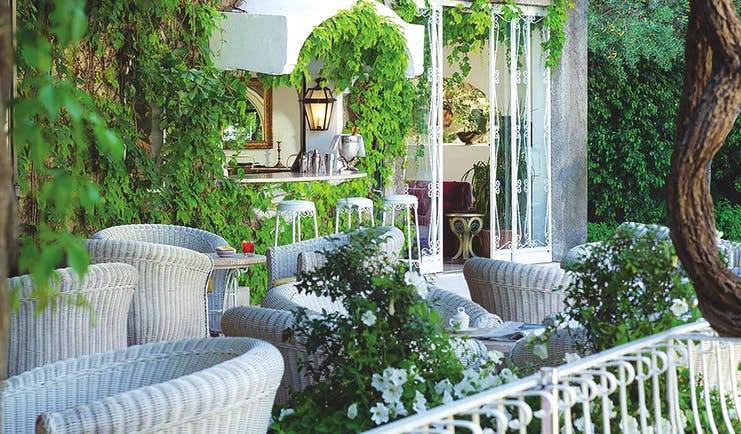 Hotel Poseidon Amalfi Coast bar indoor and outdoor seating building covered with leaves