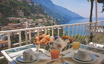 Hotel Poseidon Amalfi Coast breakfast on the balcony continental breakfast view of the coast