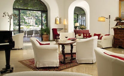 Hotel Poseidon Amalfi Coast indoor seating piano doors leading to outdoor terrace seating