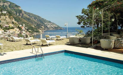 Hotel Poseidon Amalfi Coast pool sun loungers on terrace overlooking the sea