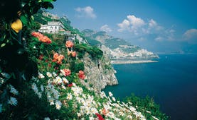 Hotel Santa Caterina Amalfi Coast exterior cliffside view hotel and coastline flowers in foreground