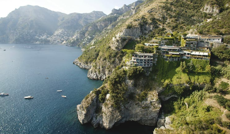 Bird's eye view of the Il San Pietro Di Positano shown on the edge of the sea in the mountains