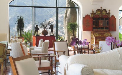 Il San Pietro di Positano lobby with white sofas and potted plants around the room