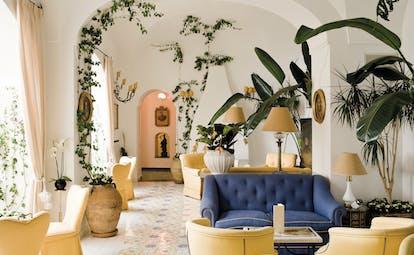 Le Sirenuse Amalfi Coast indoor lounge seating area sofas armchairs