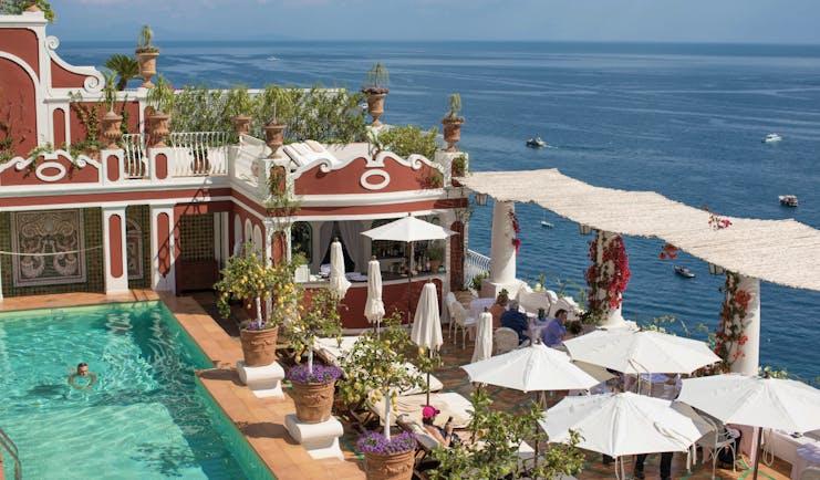 Le Sirenuse Amalfi Coast pool and dining terrace overlooking the ocean
