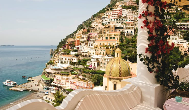 Le Sirenuse Amalfi Coast view from hotel balcony of cliffside town Positano and coast