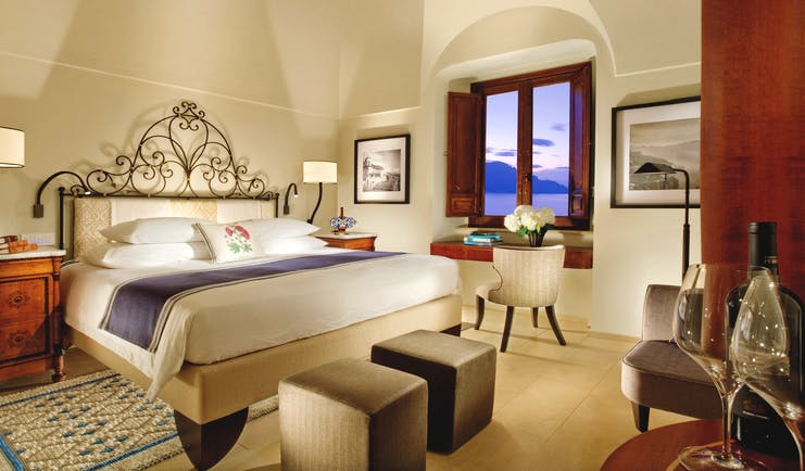 Monastero Santa Rosa Amalfi Coast deluxe room bed and bedroom furniture