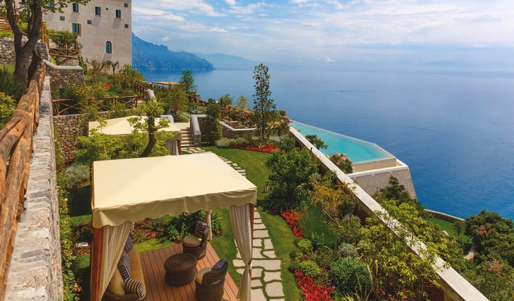 Monastero Santa Rosa Amalfi Coast gardens view of pool and ocean cabanas on lawn